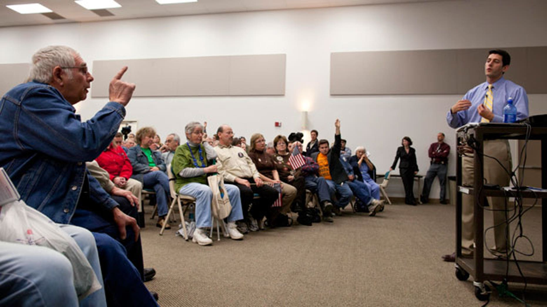 A man makes a point to U.S. Rep. Paul Ryan, R-Wis., right, as he speaks during a listening session Tuesday, April, 26, 2011 at Gateway Technical College in Kenosha, Wis. (AP)