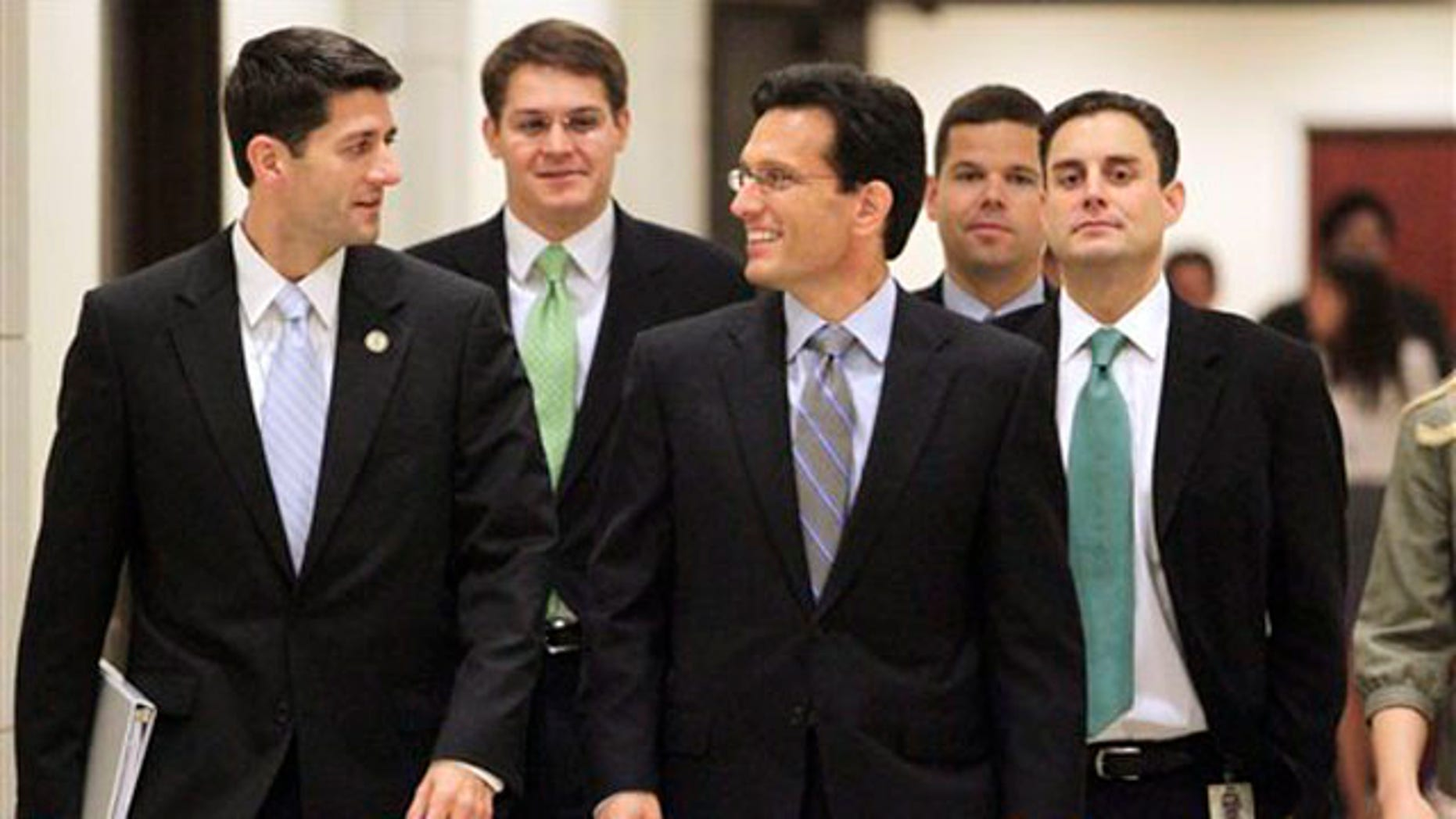 House Budget Committee Chairman Paul Ryan, left, and House Majority Leader Eric Cantor, center, and others walk to a news conference on Capitol Hill in Washington Aug. 1.