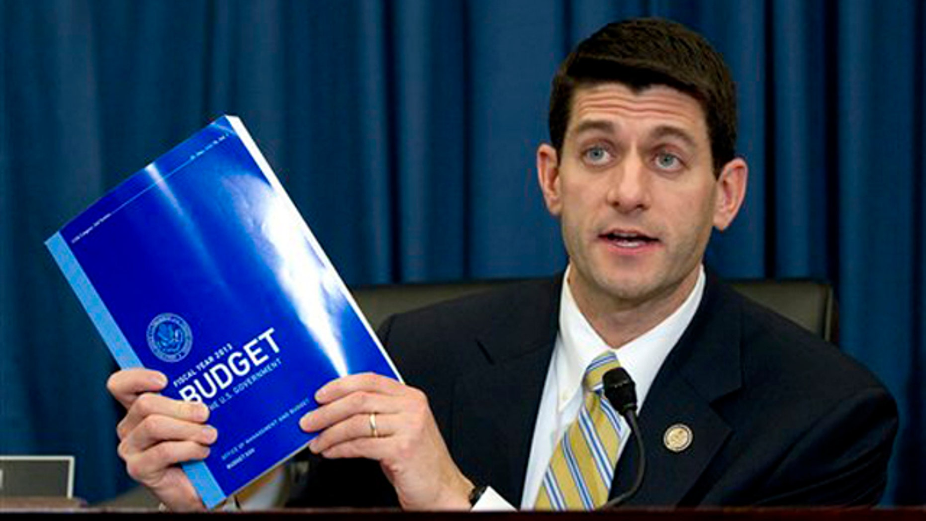 Feb. 16, 2012: House Budget Committee Chairman Rep. Paul Ryan holds up a copy of President Obama's fiscal 2013 federal budget during a hearing on Capitol Hill.