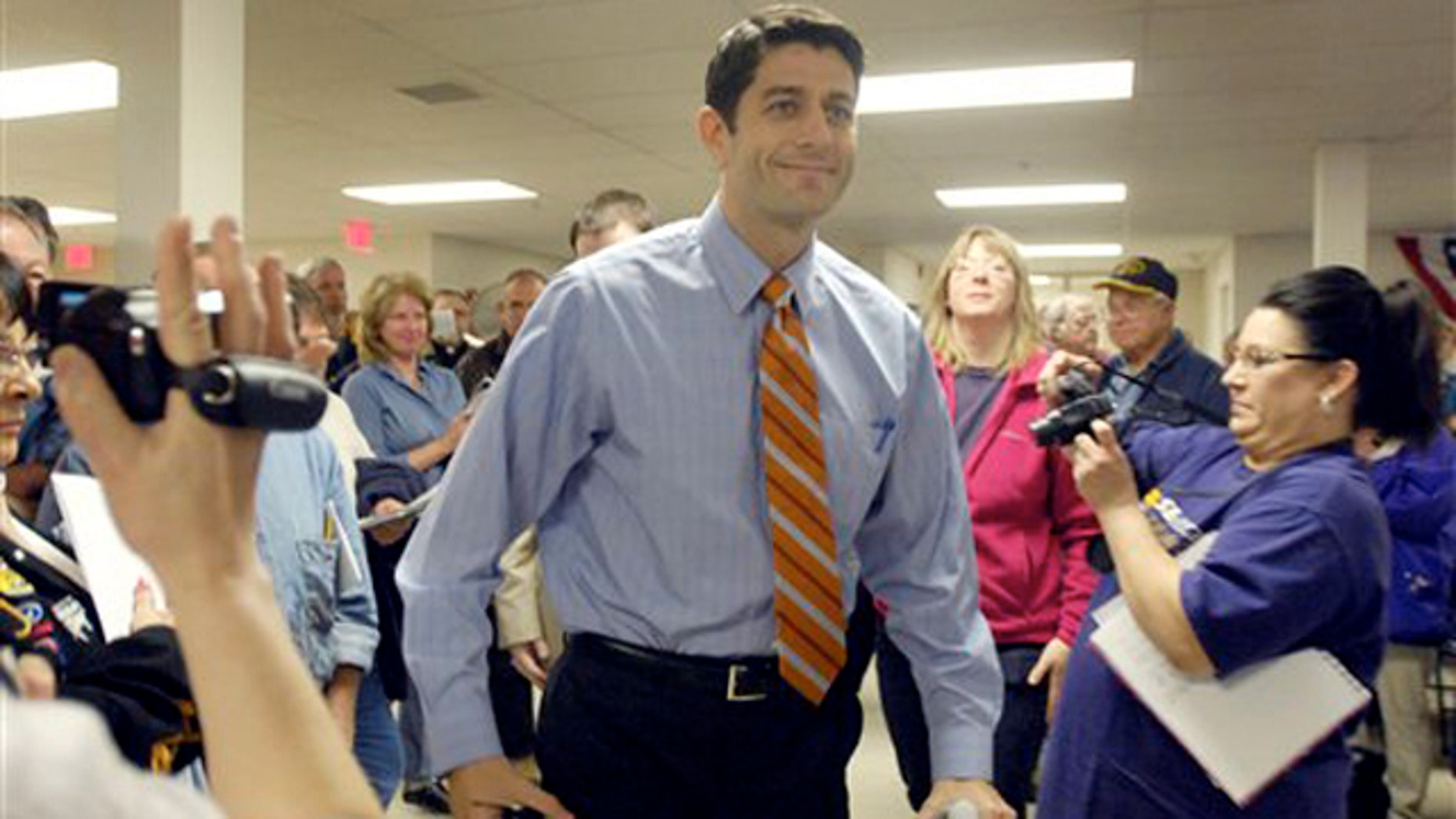 Rep. Paul Ryan arrives at a town hall meeting April 28 in Waterford, Wis.