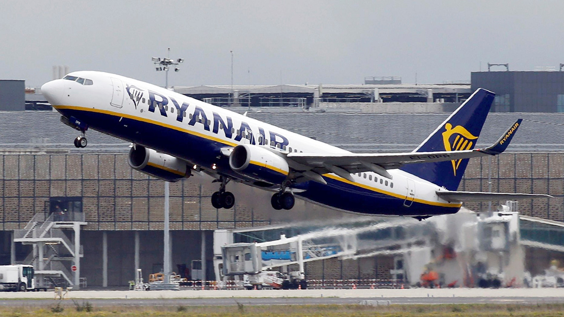 The incidents took place aboard a Ryanair flight from Riga, in Latvia, to Manchester, England. Bajalis was arrested upon arrival in Manchester.