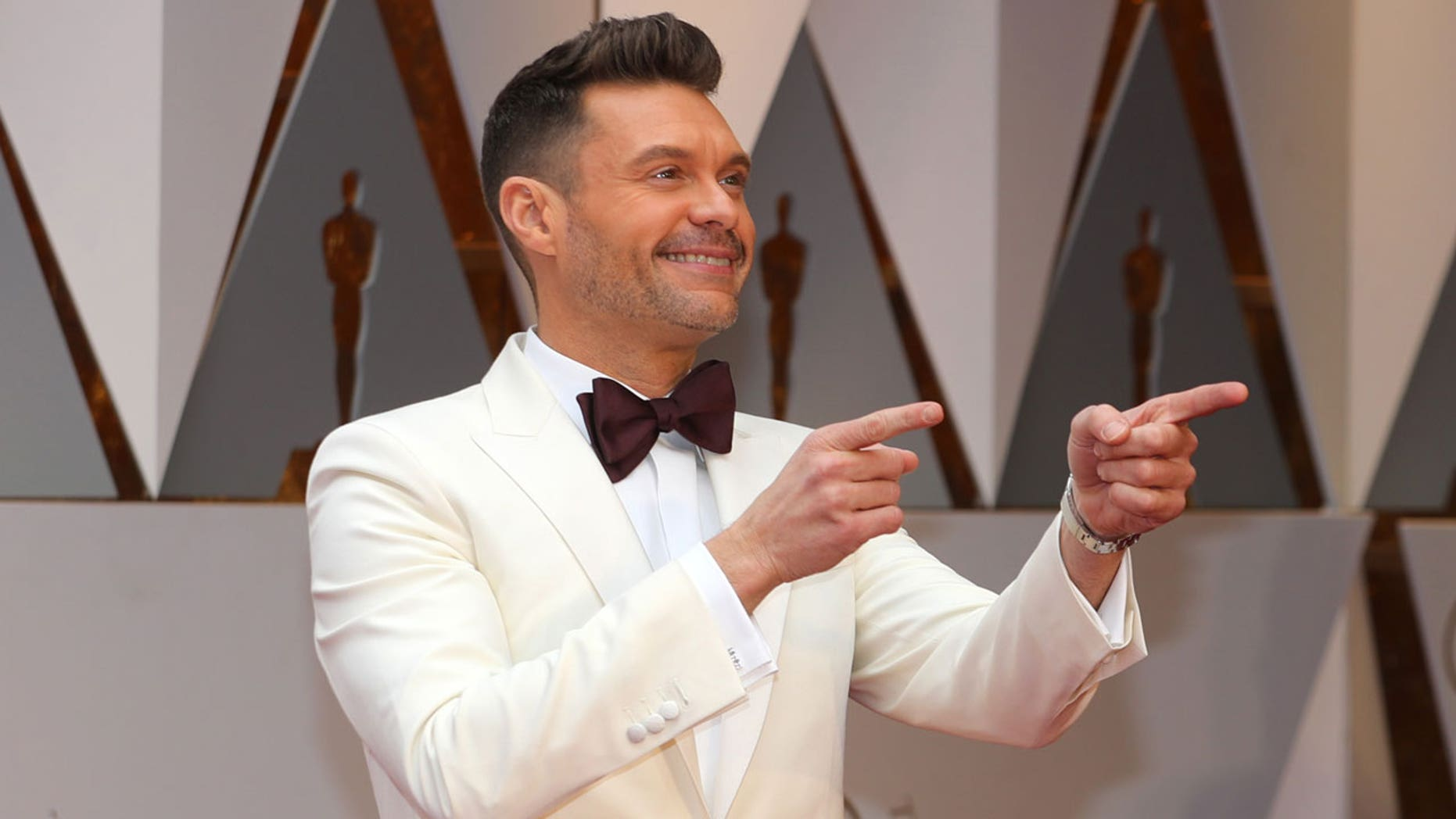 Seacrest and Ryan will soon live within shouting distance of each other's extravagant homes.