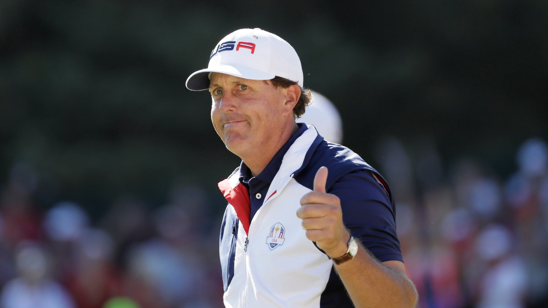 Phil Mickelson gives a thumbs up after playing the 15th hole during a singles match at the Ryder Cup tournament.