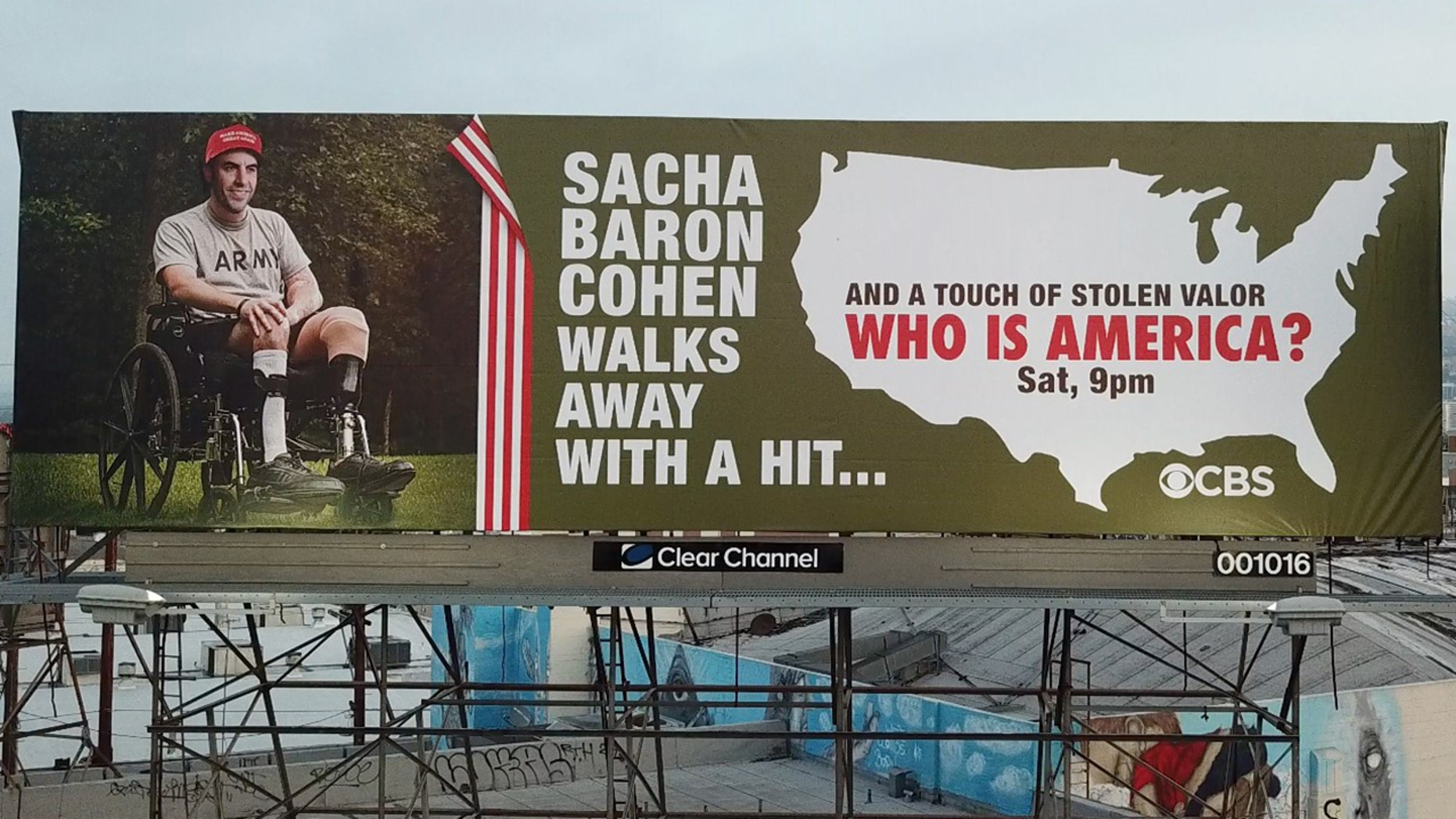 Street artist Sabo has posted a billboard that accuses Sacha Baron Cohen of stolen valor.