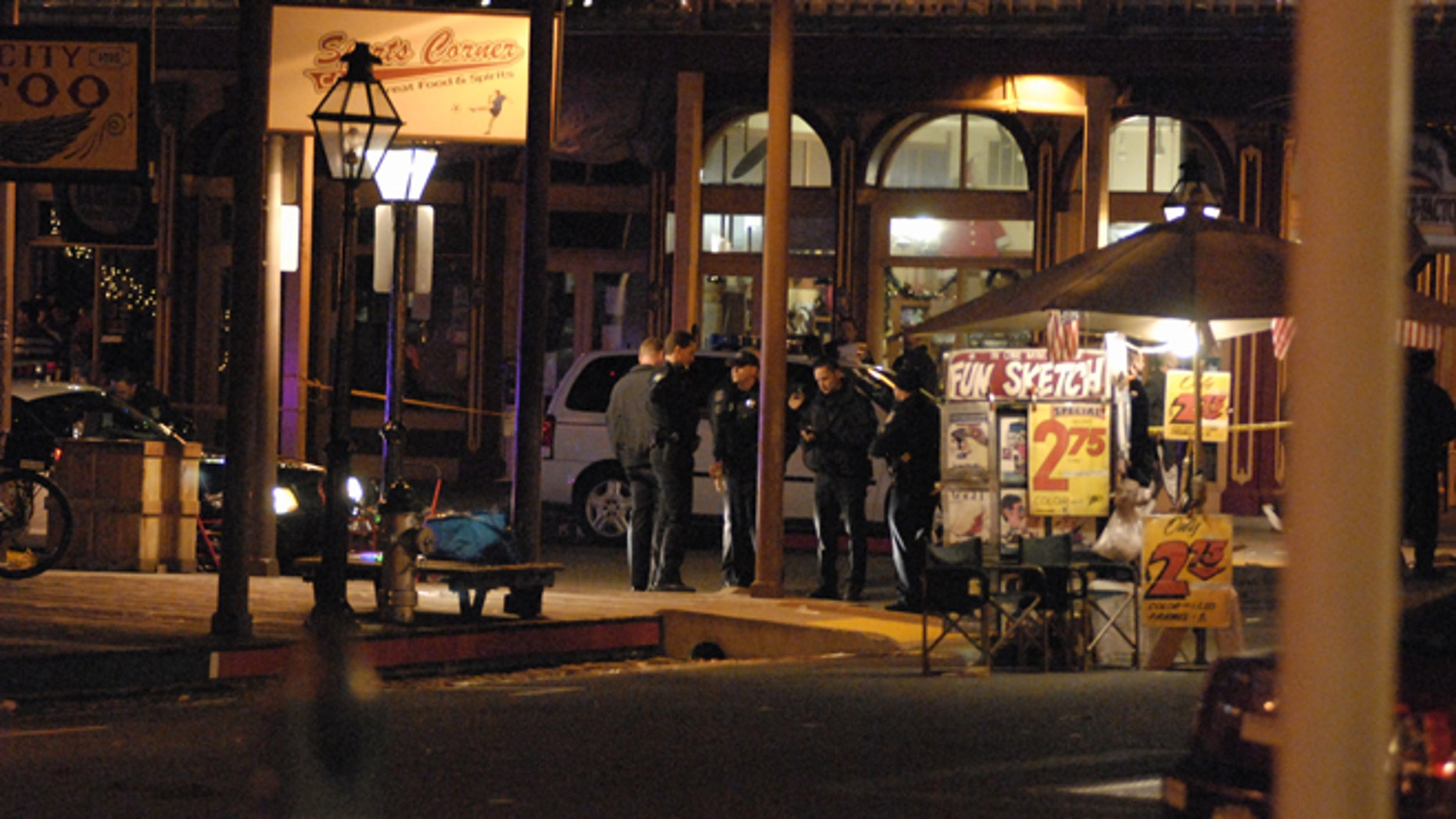 Dec. 31, 2012: In this image provided by Robert Petersen police inspect the scene of a shooting outside the Sports Corner Cafe in Sacramento Calif. (AP)