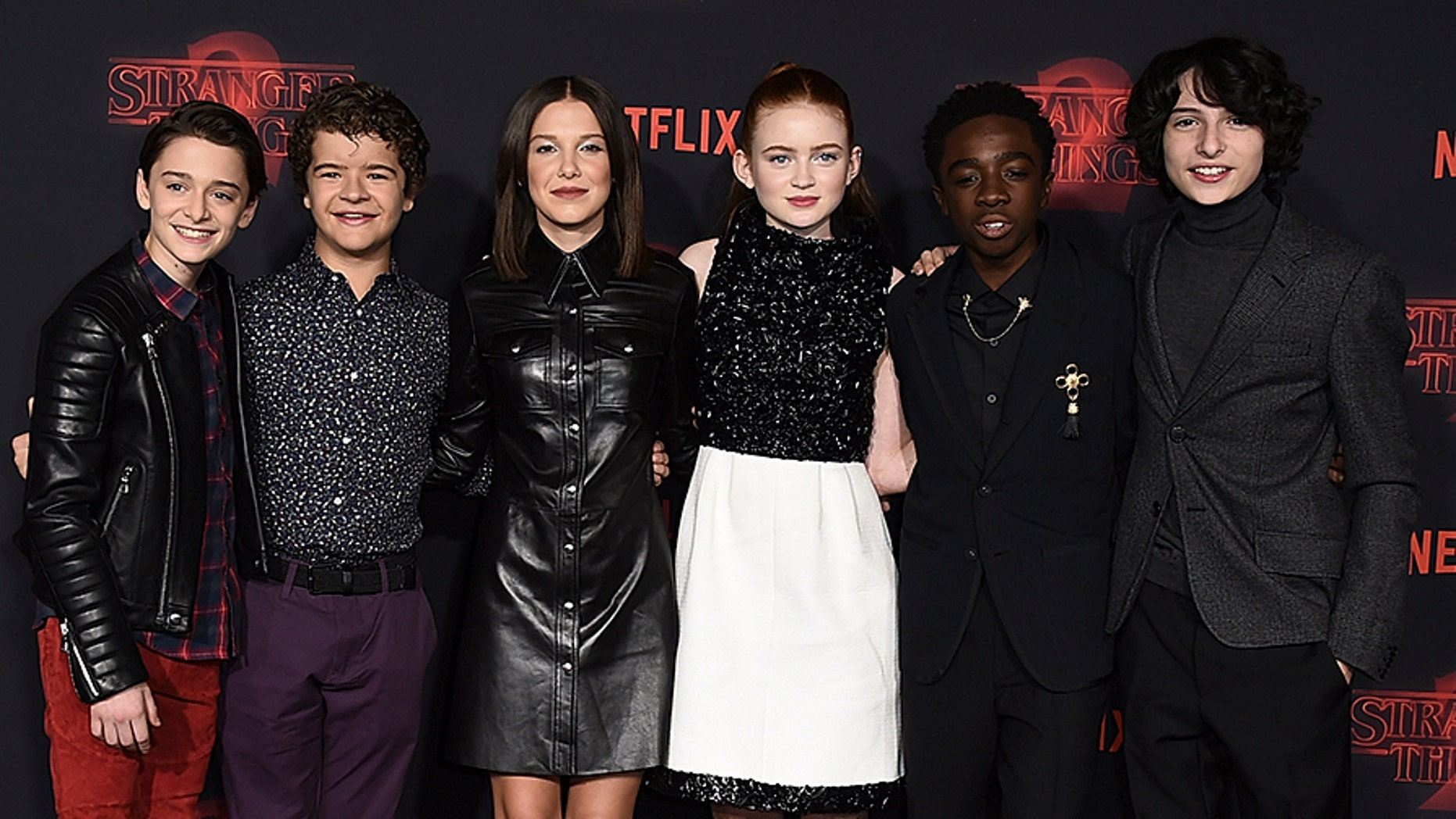 """Noah Schnapp, from left, Gaten Matarazzo, Millie Bobby Brown, Sadie Sink, Caleb McLaughlin and Finn Wolfhard arrive at the premiere of """"Stranger Things"""" season two at the Regency Bruin Theatre on Thursday, Oct. 26, 2017, in Los Angeles. (Photo by Jordan Strauss/Invision/AP)"""
