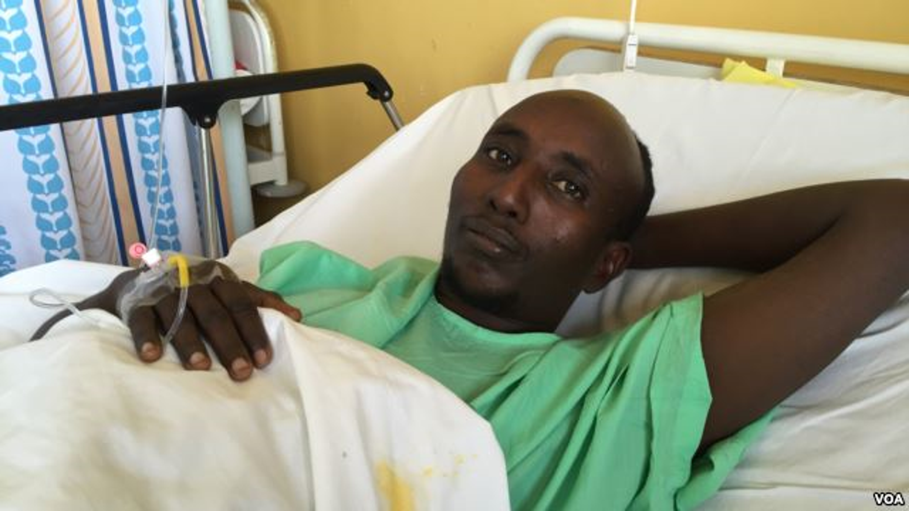Salah Farah was shot when the bus he was traveling in was attacked by al-Shabaab militants in December 2015. (J. Craig/VOA)