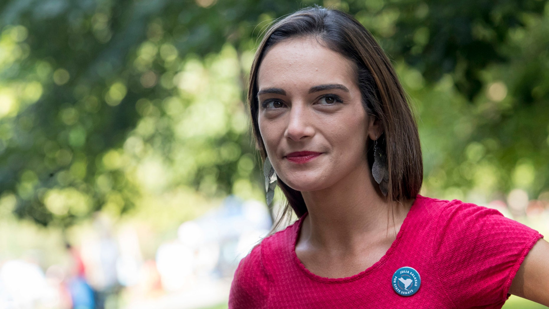 In this Aug. 15, 2018 file photo, Democratic New York state Senate candidate Julia Salazar smiles as she speaks to a supporter before a rally in McCarren Park in Brooklyn. Salazer said Sep. 11 that she was sexually assaulted five years ago by David Keyes , a spokesman for Israeli Prime Minister Benjamin Netanyahu, an accusation he denies. (AP Photo/Mary Altaffer, File)