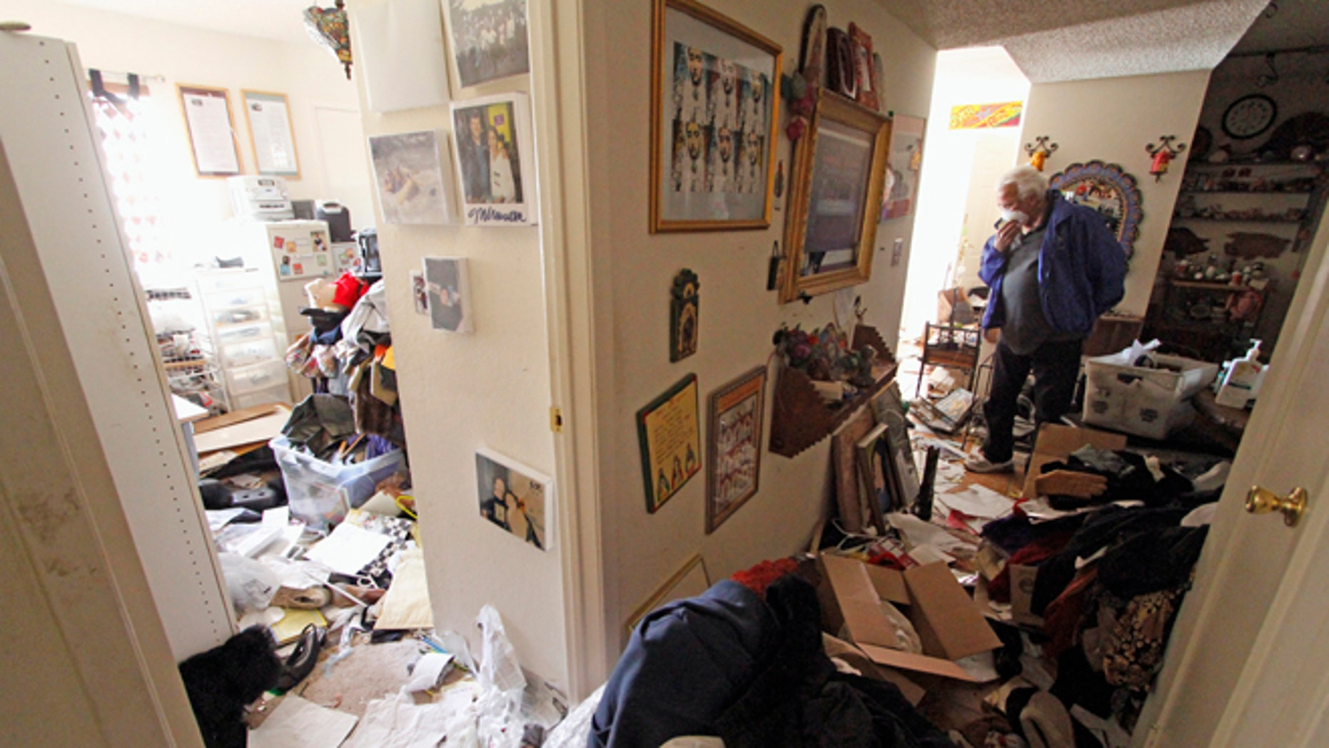 May 10, 2013: Louis Ponce, brother-in-law of Bobbi Salinas-Norman, walks through the apartment where Salinas-Norman was found dead.   Ponce discovered the remains of Salinas-Norman, a Chicana activist, teacher and author, last week and authorities say she may have been dead for more than a year.    (AP)