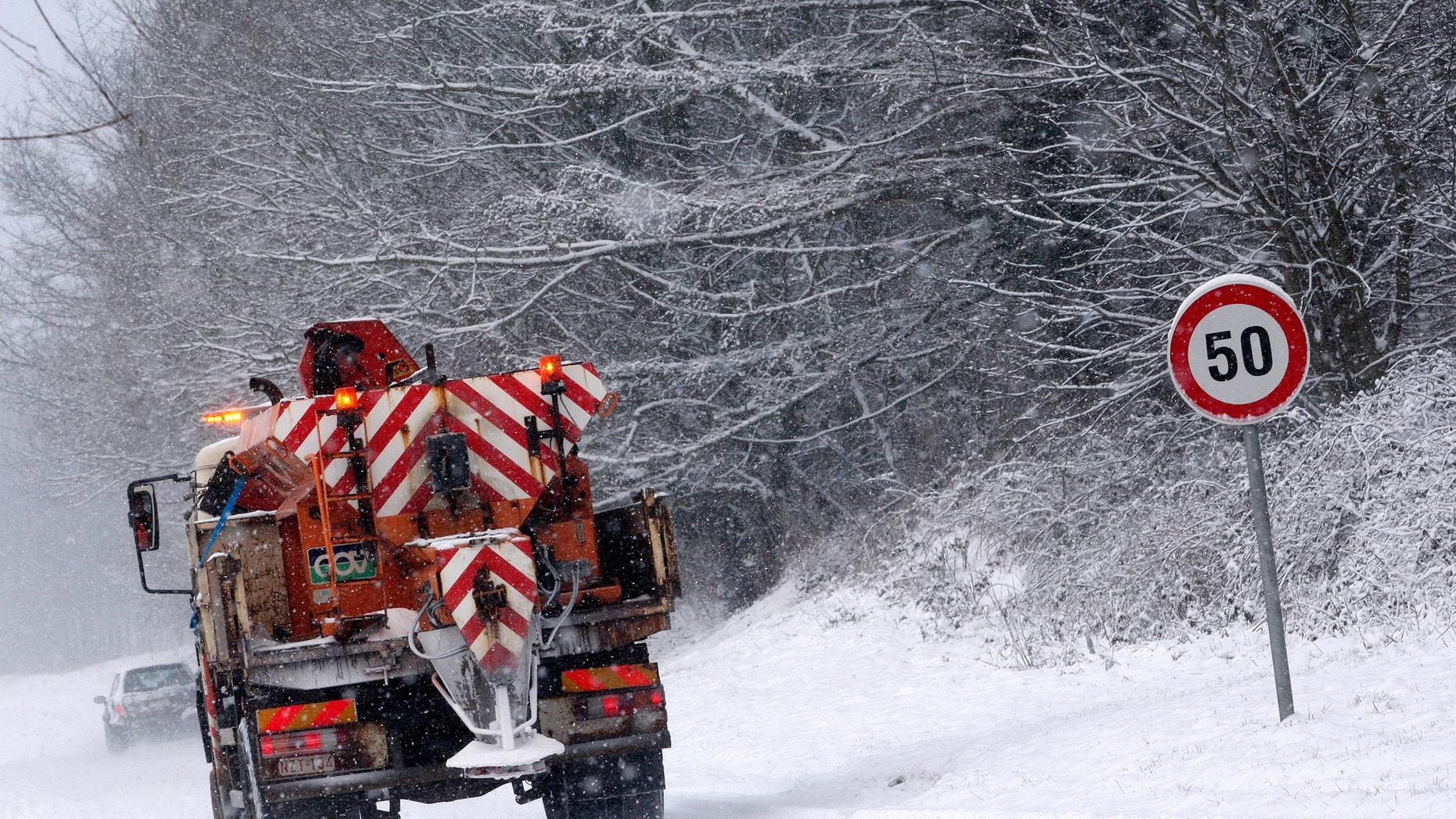 File photo: A truck spreads salt on a road in Sterrebeek February 10, 2010. (REUTERS/Sebastien Pirlet)