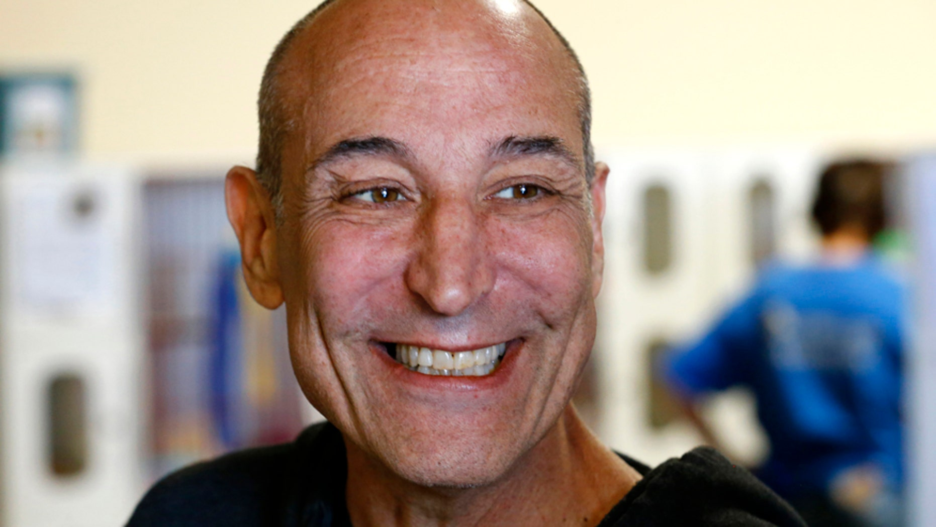 Hollywood mogul and co-creator of The Simpsons, Sam Simon, smiles while visiting the San Diego Humane Society after he financed the purchase of a chinchilla farm in order to rescue over 400 chinchillas and shutter the business in Vista, California August 19, 2014.
