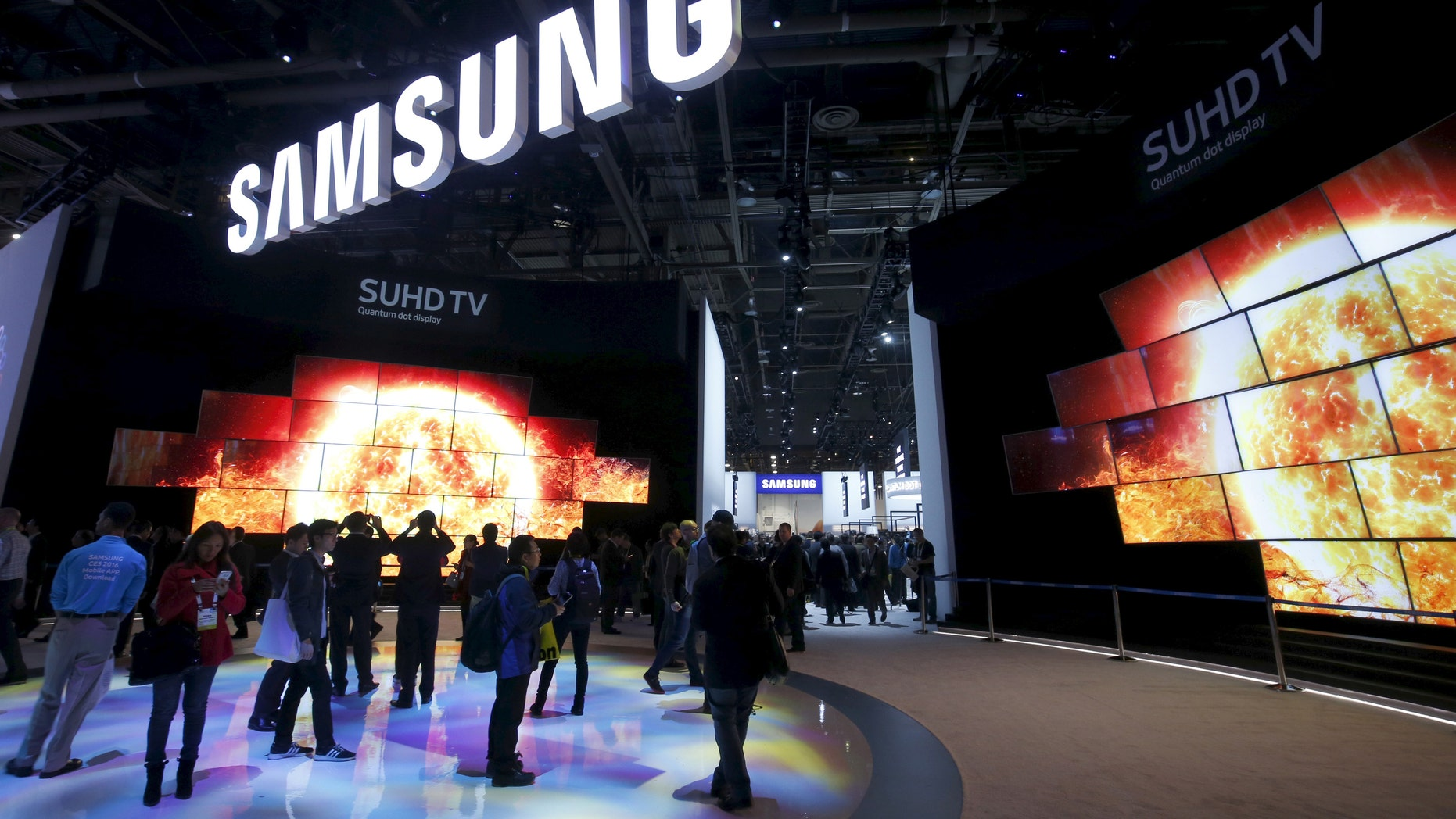 "File photo - ""Quantum Dot"" SUHD televisions are displayed at the Samsung Electronics booth during the 2016 CES trade show in Las Vegas, Nevada Jan. 7, 2016. (REUTERS/Steve Marcus)"