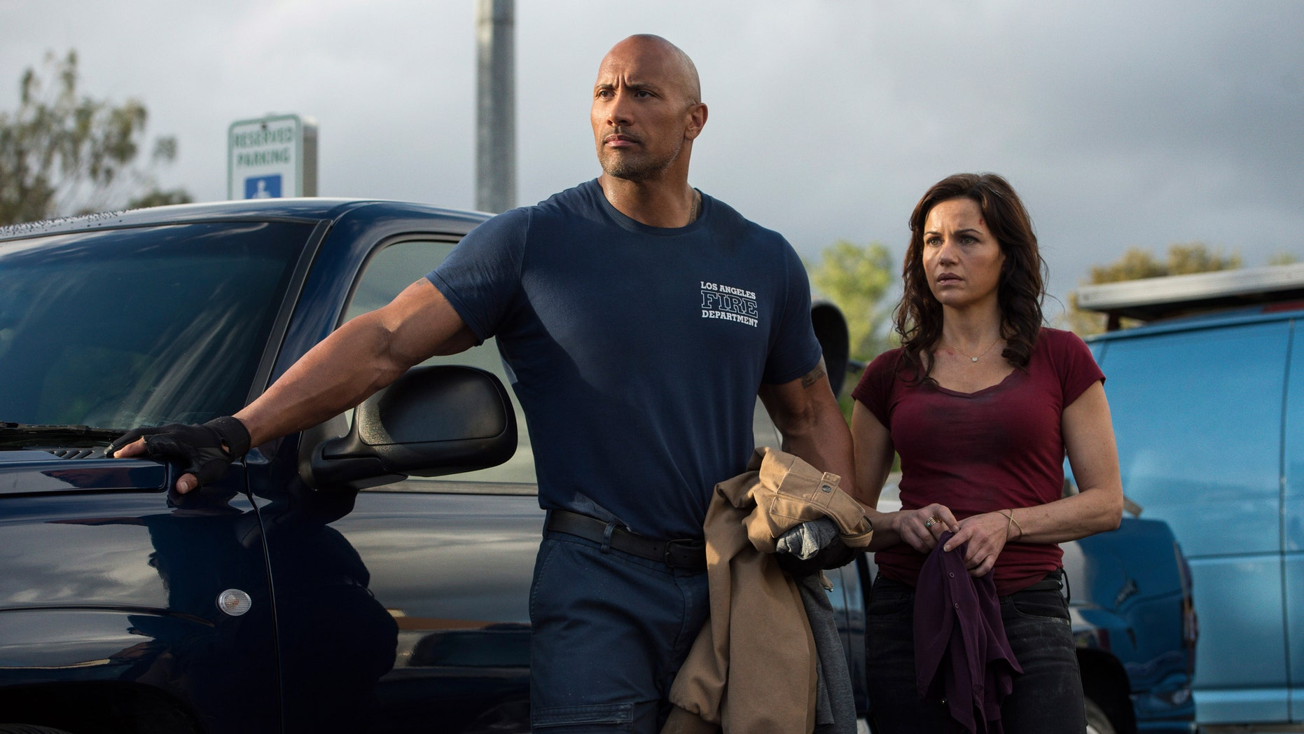 "Dwayne Johnson, left, as Ray, and Carla Gugino as Emma in ""San Andreas."""