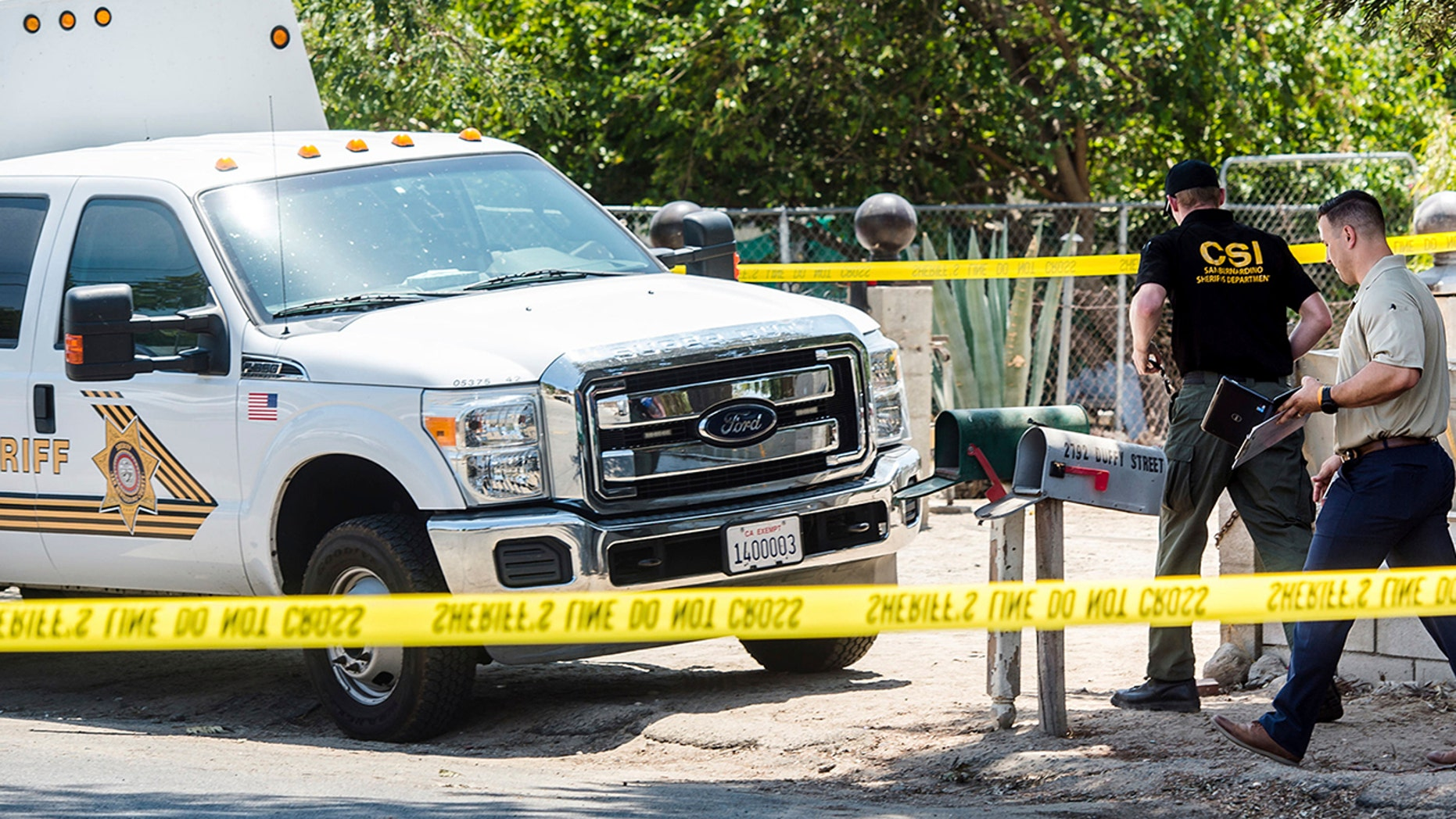 San Bernardino County Sheriff's personnel investigate the scene of a fatal shooting in Muscoy, Calif., on Friday.