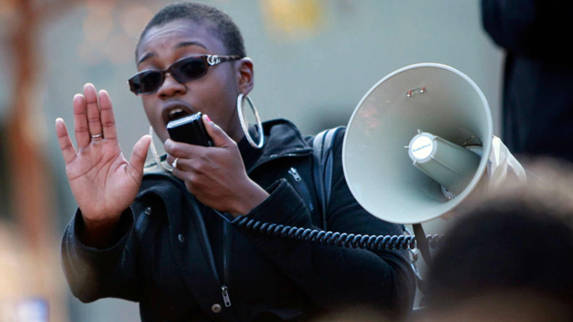 Nov. 21, 2013: Champagne Ellison, a senior at San Jose State University, speaks at a rally protesting a reported racial hazing of an African-American freshman last month in San Jose, Calif.