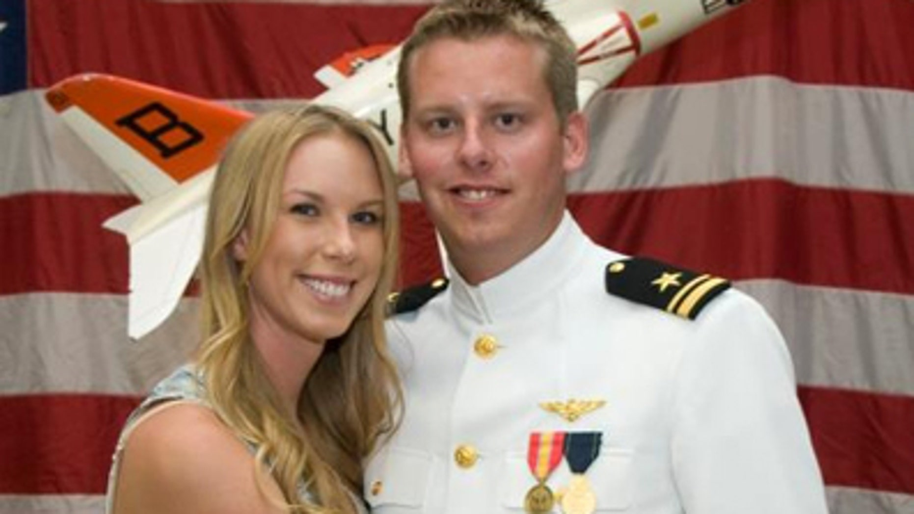 January 2, 2011: This photo provided by the Reis family shows Karen Reis, left, and her brother David Reis at his winging ceremony for the Navy.