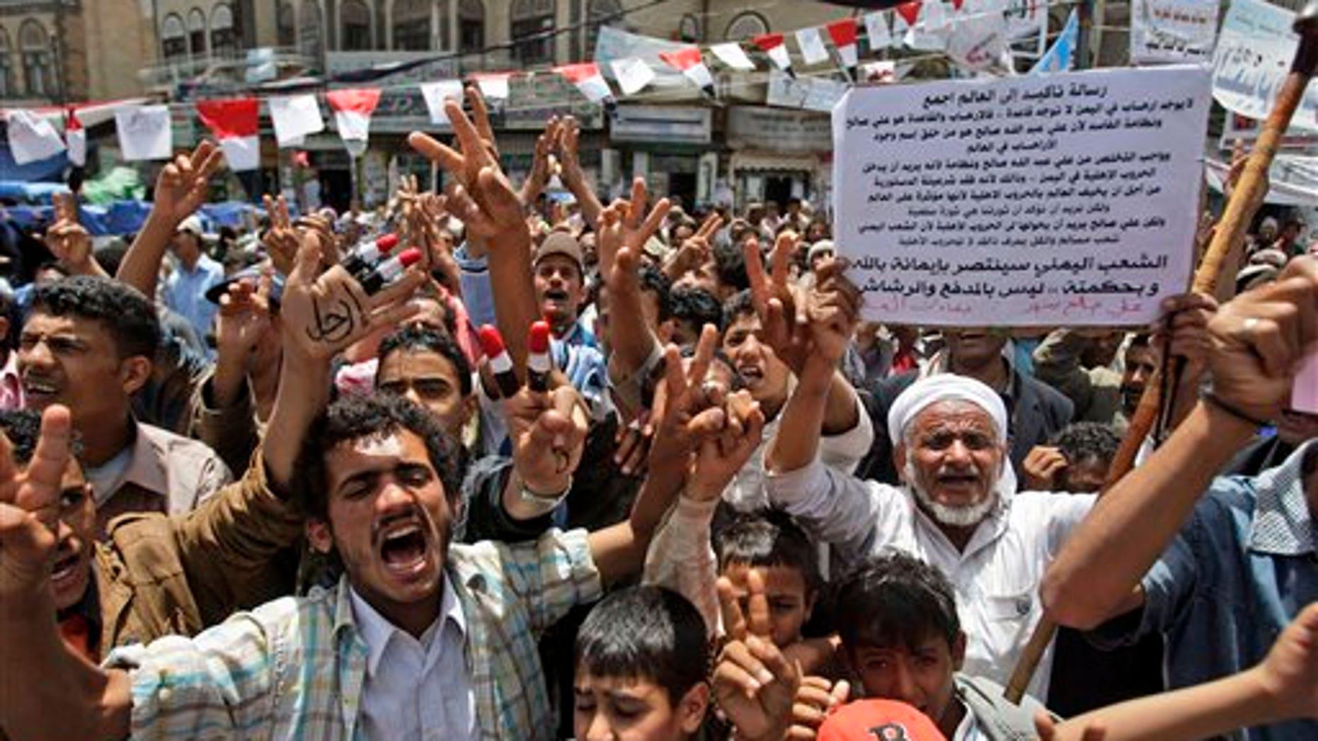 May 29: Anti-government protestors shout slogans during a demonstration demanding the resignation of Yemeni President Ali Abdullah Saleh in Sanaa, Yemen. (AP)
