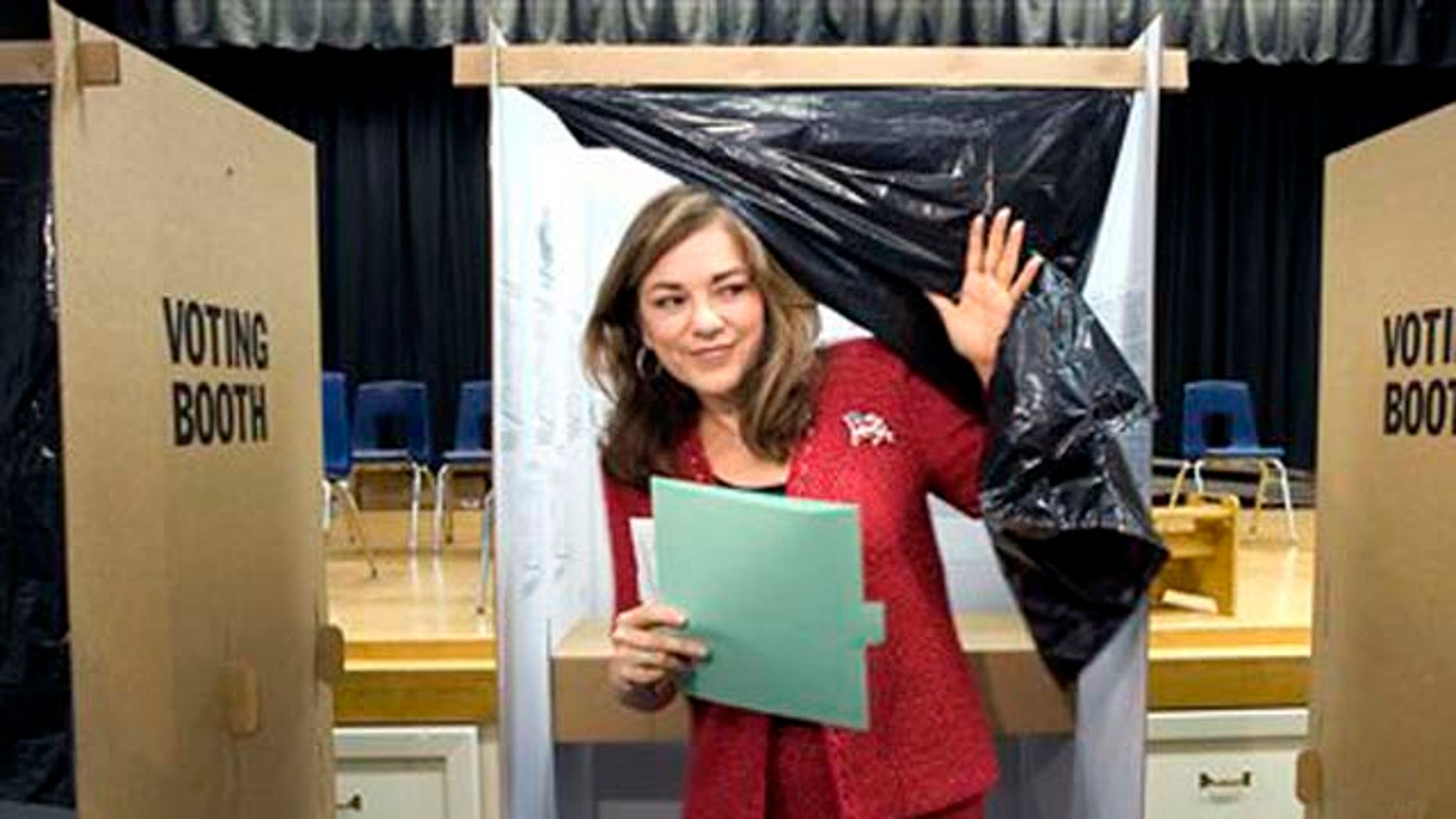 Democratic Congresswoman Loretta Sanchez emerges from a voting booth after casting her ballot at Santiago Elementary School in Santa Ana, Calif. on  Tuesday, Nov. 2, 2010.  (AP Photo/The Orange County Register, H. Lorren Au Jr. )