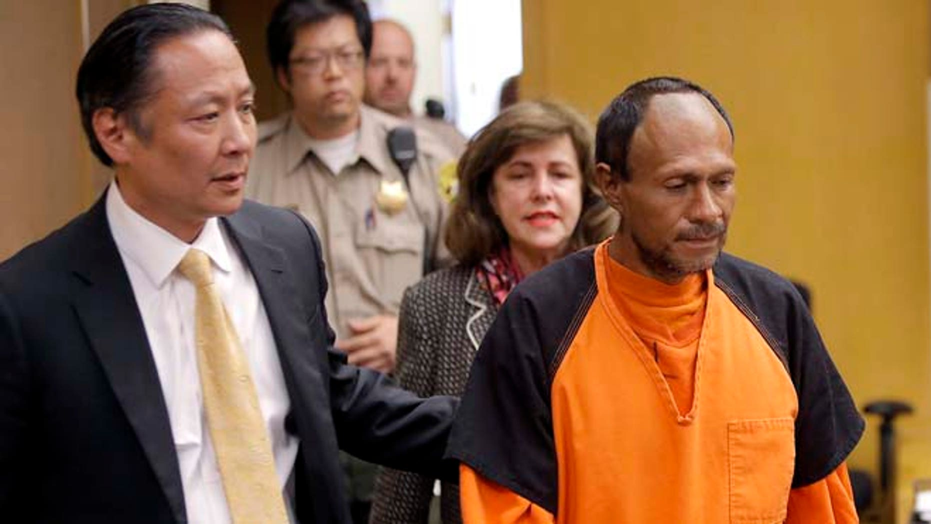 FILE - In this Tuesday, July 7, 2015 file photo, Juan Francisco Lopez-Sanchez, right, is lead into the courtroom by San Francisco Public Defender Jeff Adachi, left, and Assistant District Attorney Diana Garciaor, center, for his arraignment at the Hall of Justice in San Francisco. (Michael Macor/San Francisco Chronicle via AP, Pool, File)