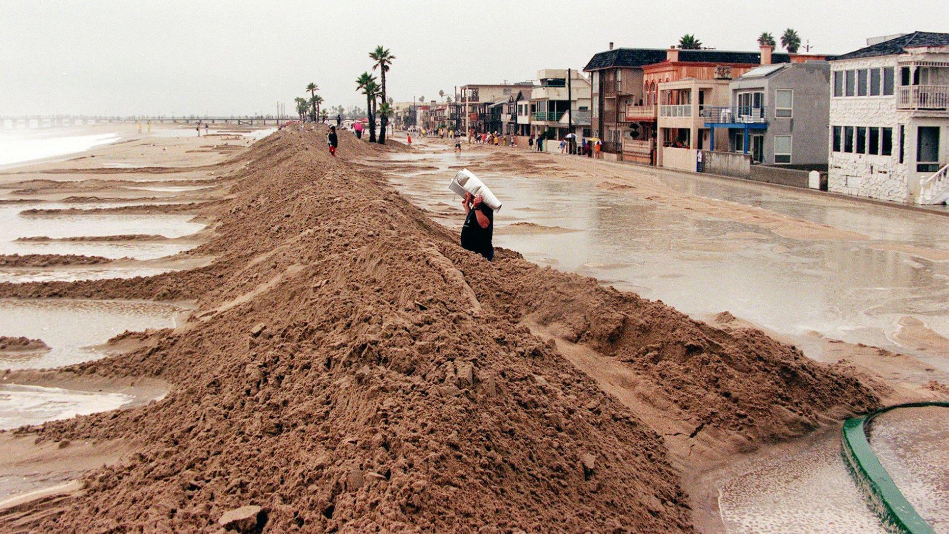 A sand dike protects the Orange County beach
