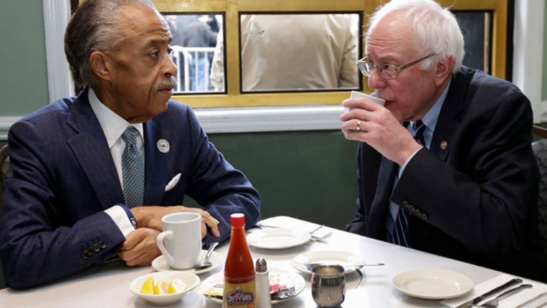 Feb. 10,, 2016: The Rev. Al Sharpton talks with Democratic presidential candidate Sen. Bernie Sanders, I-Vt. as they sit down for a breakfast meeting at Sylvia's Restaurant in the Harlem neighborhood of New York.