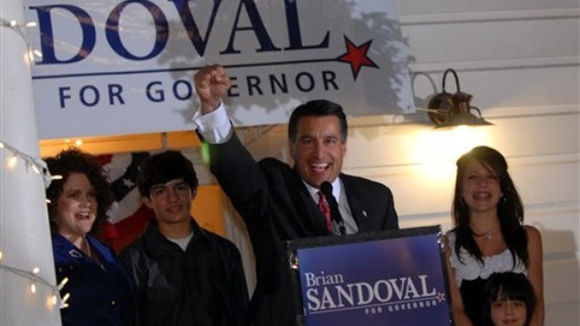 Nevada gubernatorial candidate Brian Sandoval celebrates his victory over incumbent Gov. Jim Gibbons in the GOP primary at the Garden Shop Nursery in Reno, Nev., June 8. (AP Photo)