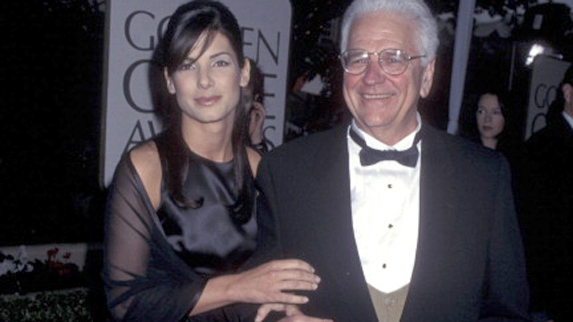 Sandra Bullock is mourning the loss of her father, John Bullock. Here, Sandra and her father attend the 53rd Golden Globe Awards on Jan. 21, 1996 in Beverly Hills, Calif.