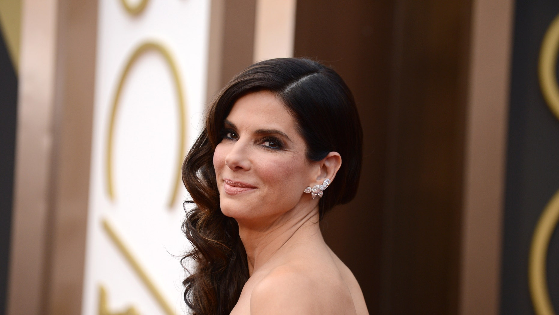 March 2, 2014. Sandra Bullock arrives at the Oscars at the Dolby Theatre, in Los Angeles.