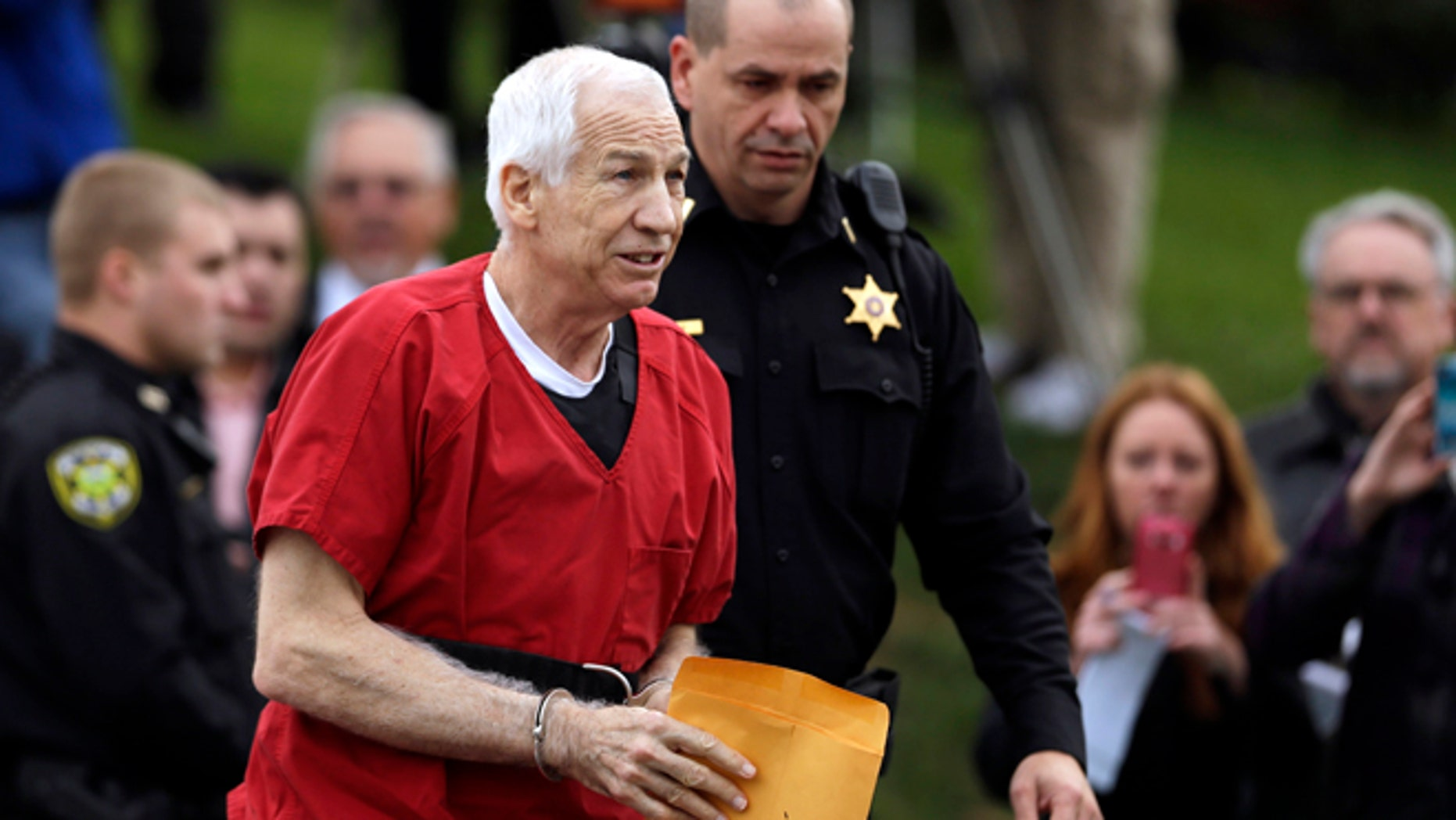 Oct. 9: Former Penn State University assistant football coach Jerry Sandusky arrives at the Centre County Courthouse for a sentencing hearing.