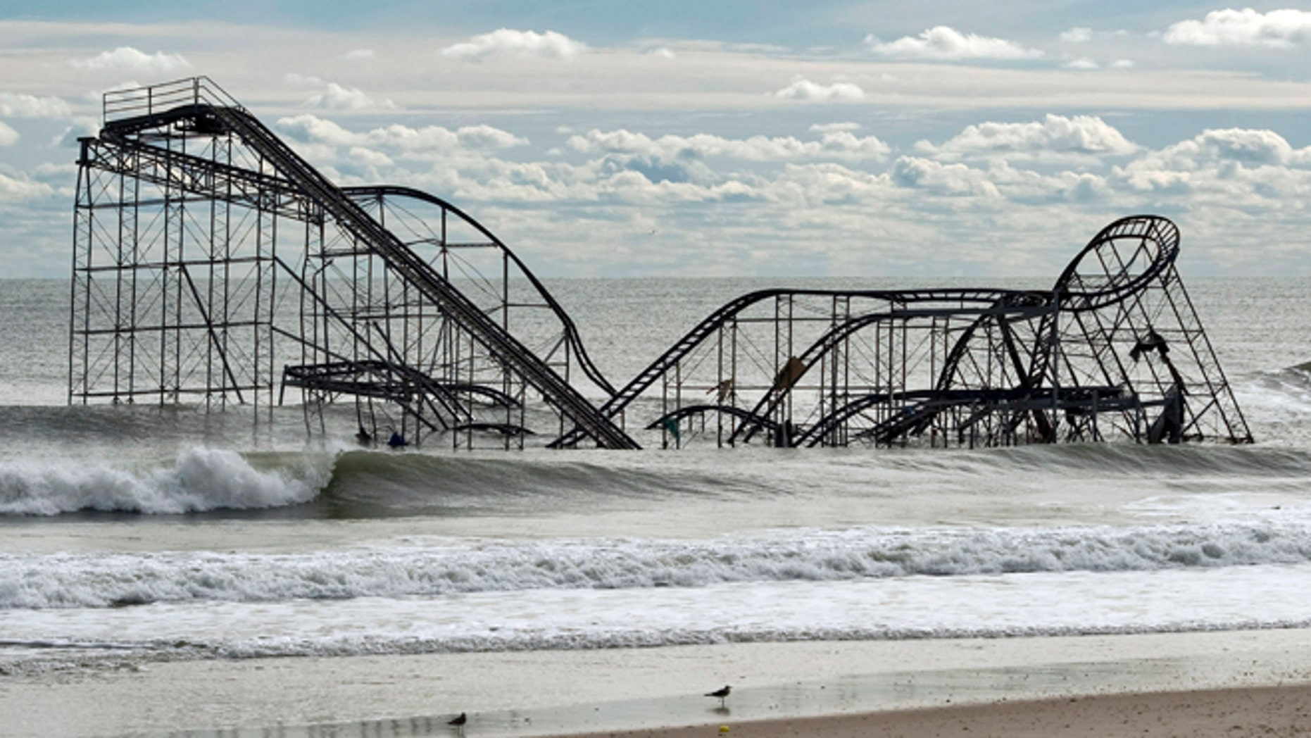 Nov. 1, 2012: The remnants of a roller coaster sits in the surf three days after Hurricane Sandy came ashore in Seaside Heights, New Jersey.