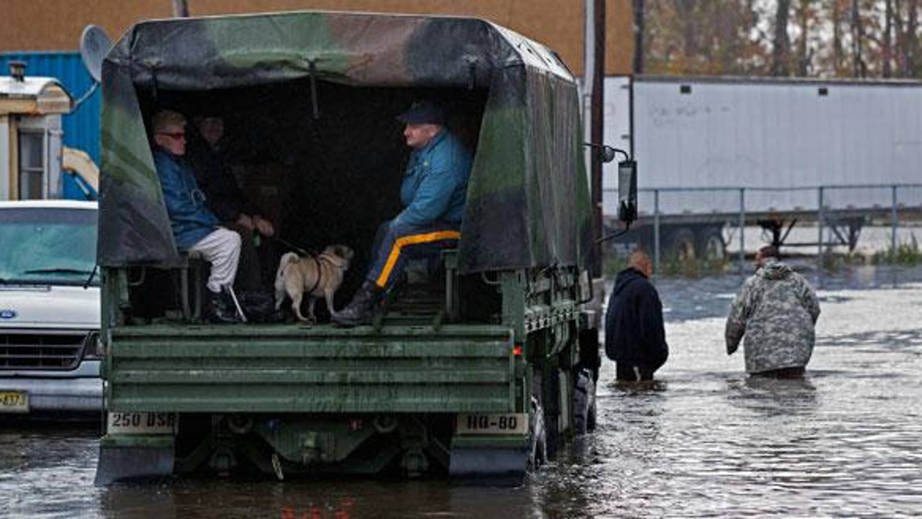 Military trucks, such as this one used earlier this week to rescue residents of a flooded Moonachie, NJ, well be sent to storm-ravaged areas of the Garden State on Election Day to be used as a make-shift polling station.