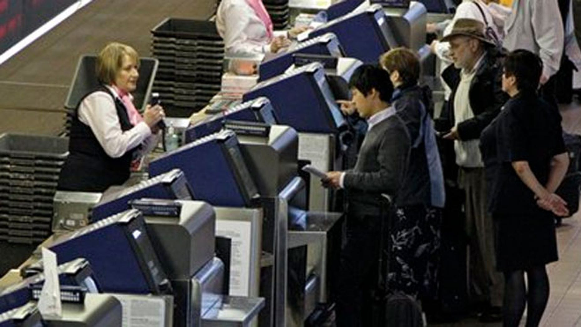 Oct. 31, 2012: Passengers check in for their flights at the US Airways ticket counter at Pittsburgh International Airport in Imperial, Pa, Wednesday.