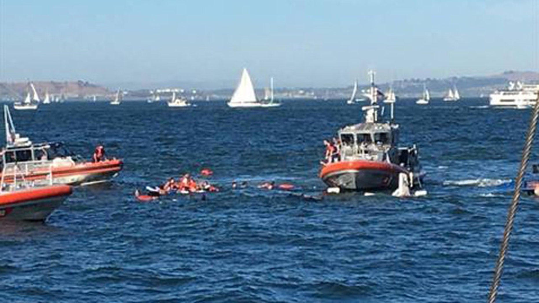 Oct. 8, 2016: Rescue boats approach passengers on a boat the capsized in San Francisco Bay Saturday. All 30 passengers were accounted for Saturday night