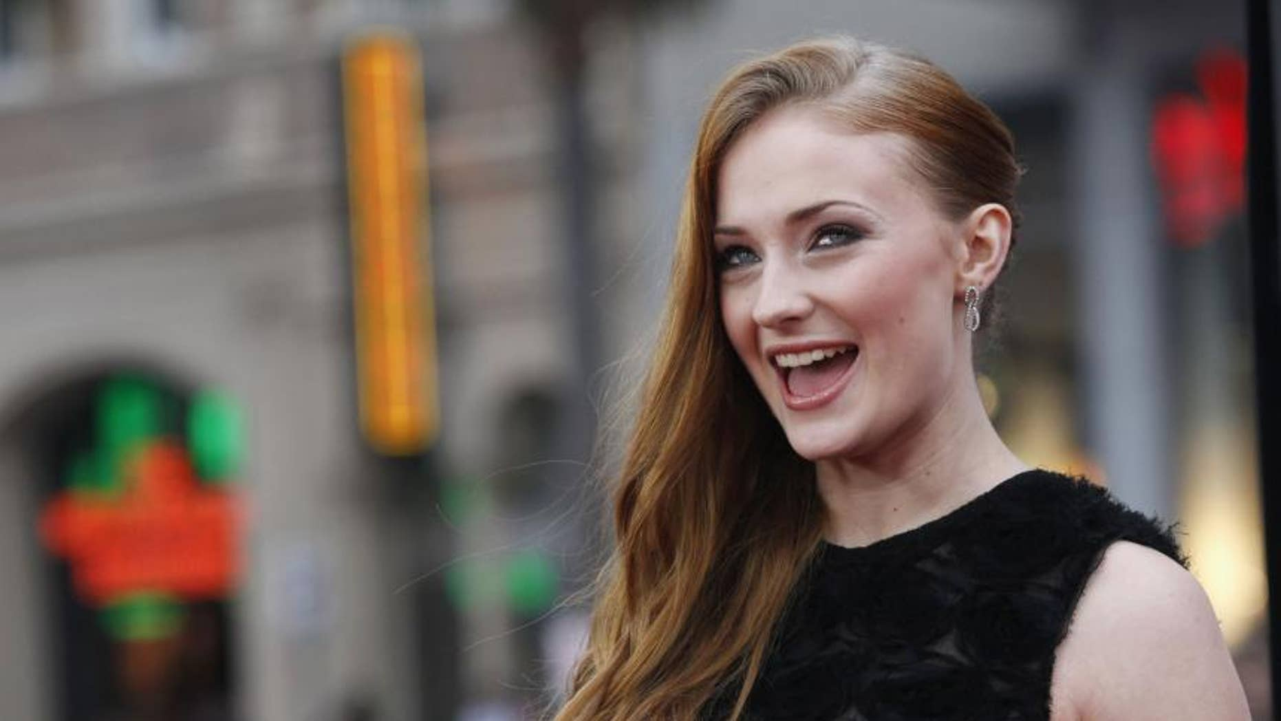 Sophie Turner chugs red wine at Rangers game with Joe Jonas