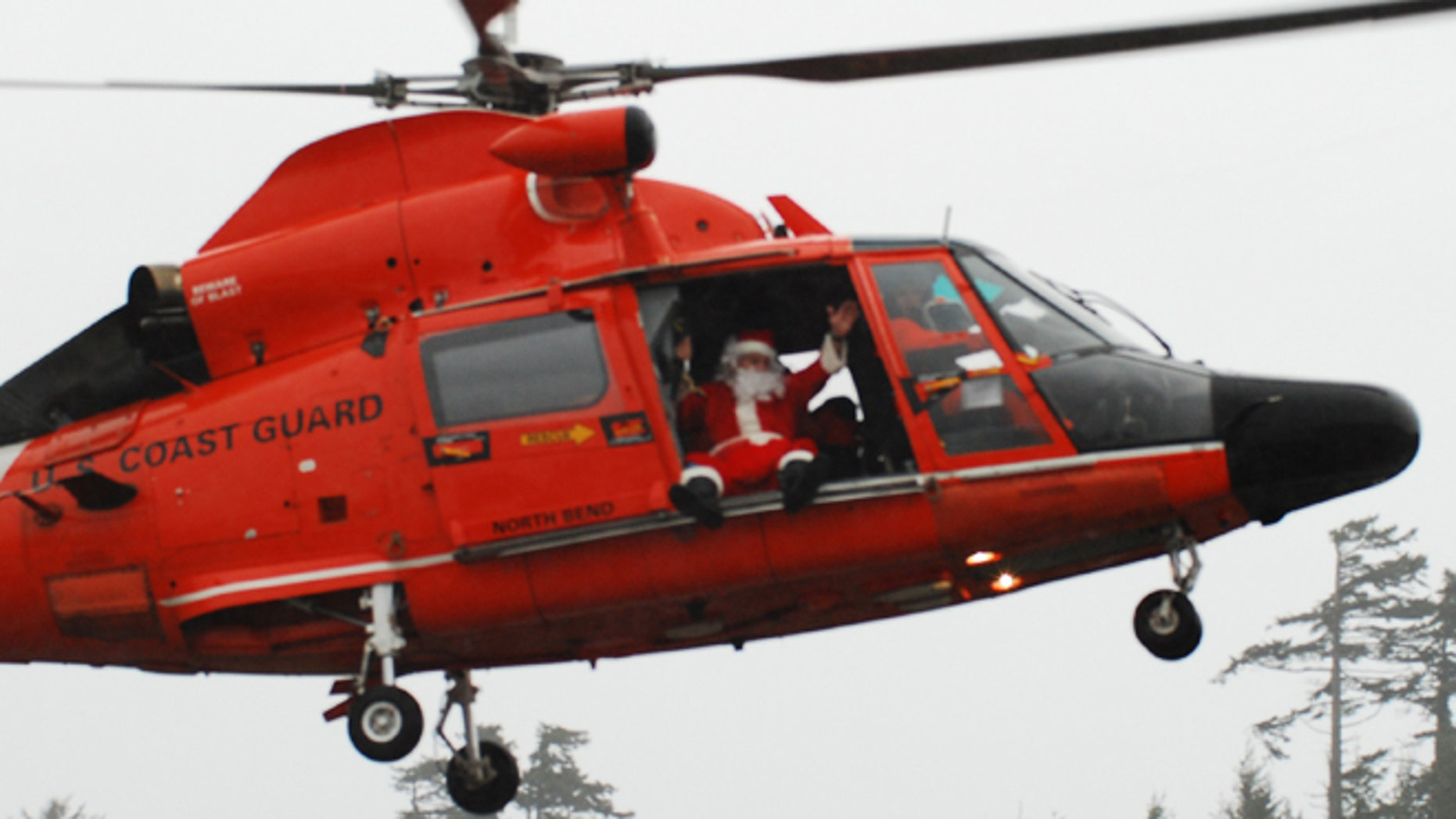 Coast Guard Master Chief Petty Officer Frank Allard arrives at the mall dressed as Santa in 2010.
