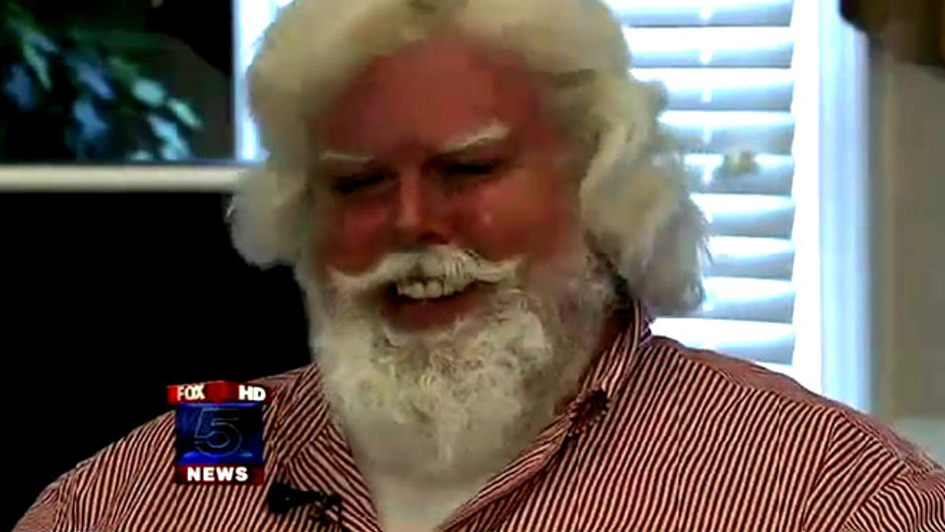 "Thomas Tolbert was told by Disney park representatives to change his clothes to look less ""Santa-ish"""