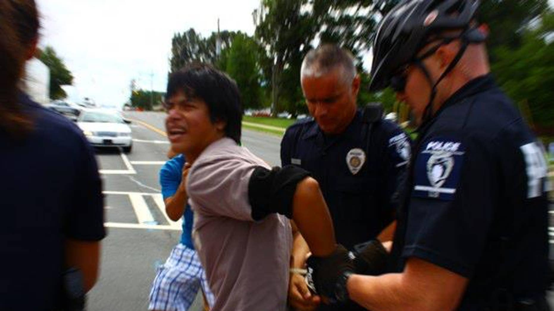 Santiago Garcia-Leco being arrested at an immigration rally.
