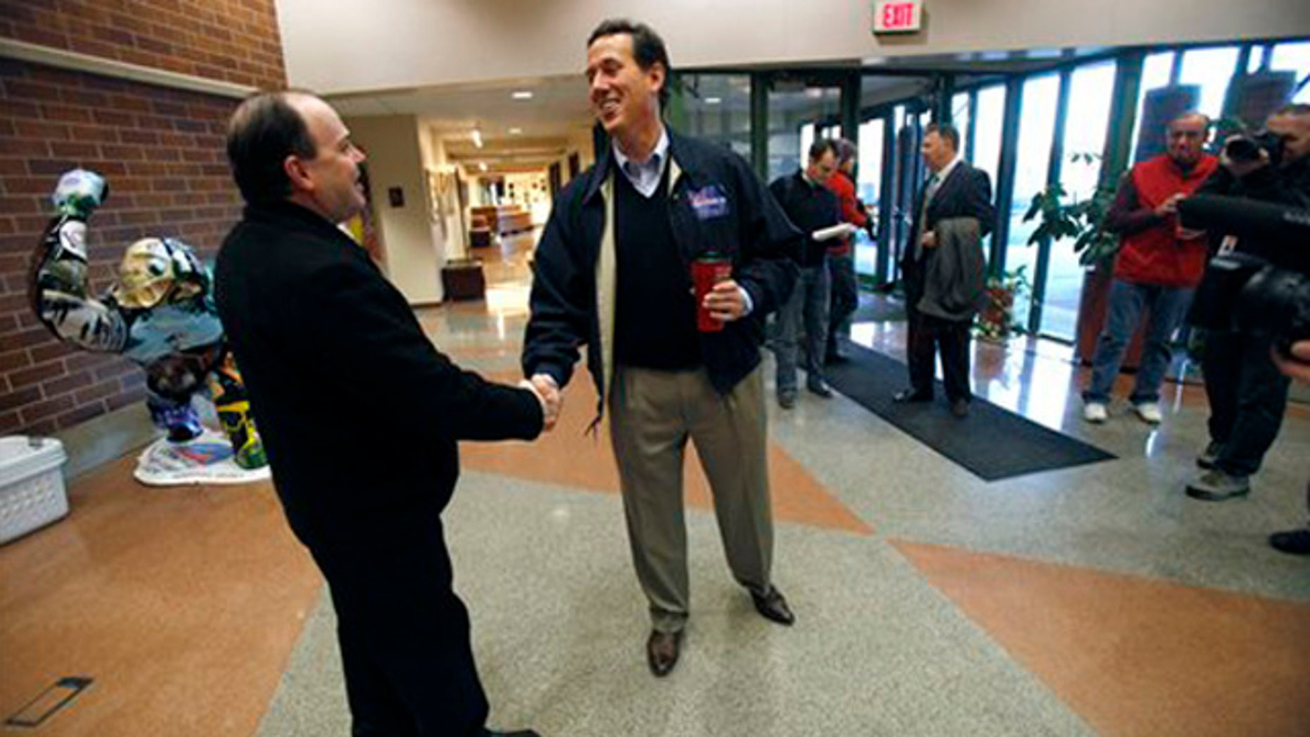 Dec. 29, 2011:  Rick Santorum arrives at a campaign stop in Coralville, Iowa.