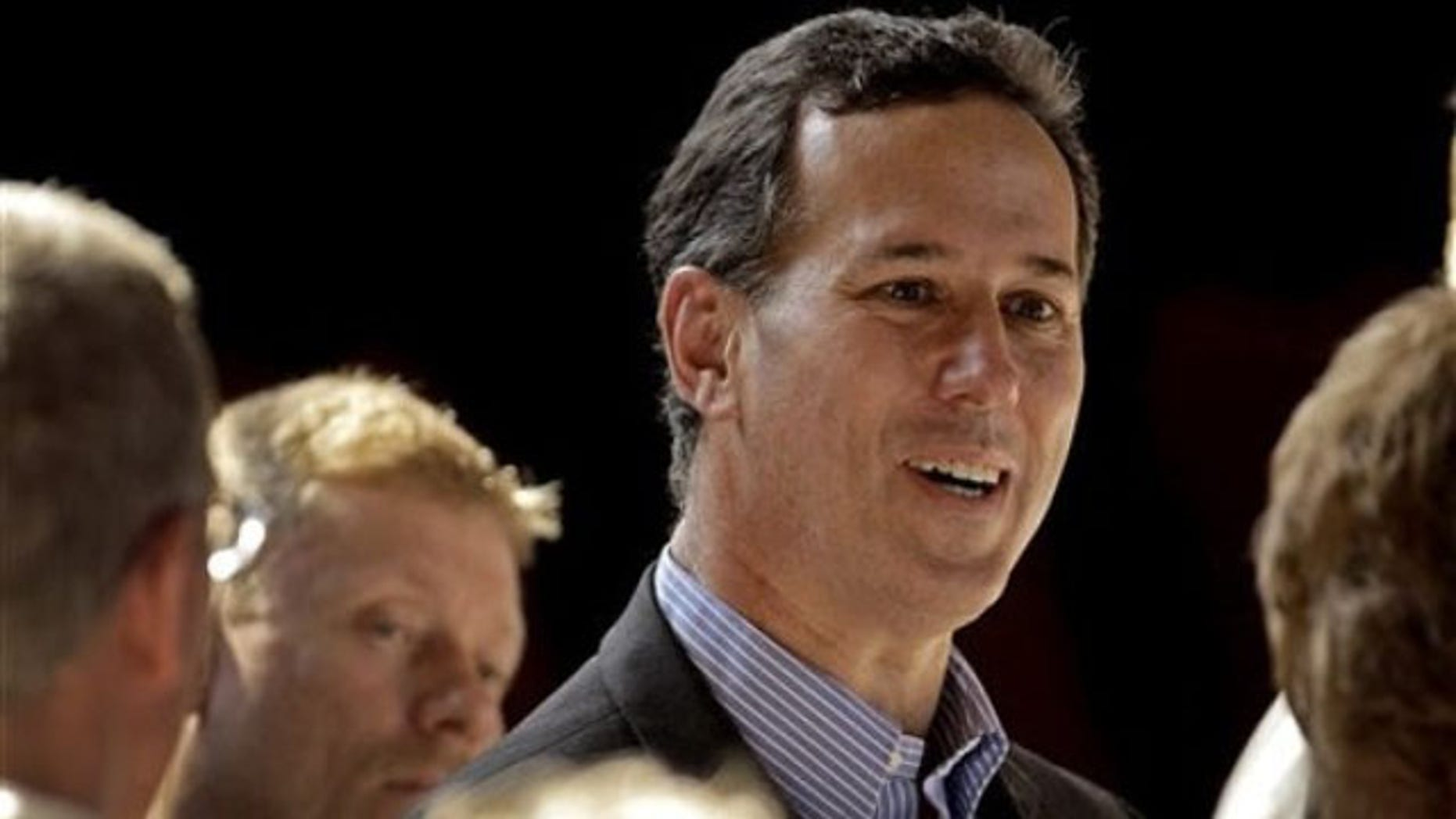 March 9, 2012: Rick Santorum greets supporters during a rally in Topeka, Kan.