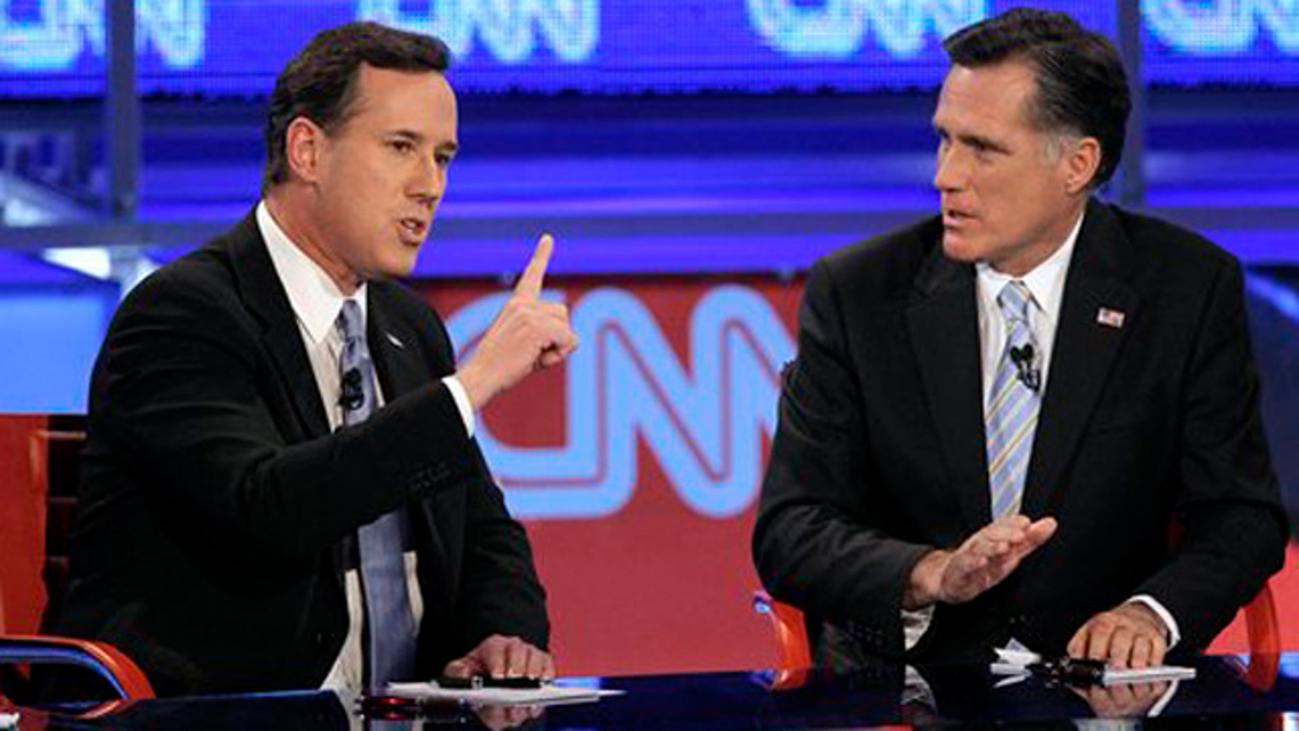 Feb. 22, 2012: Republican presidential candidate, former Pennsylvania Sen. Rick Santorum, left, makes a point as former Massachusetts Gov. Mitt Romney listens during a Republican presidential debate in Mesa, Ariz.