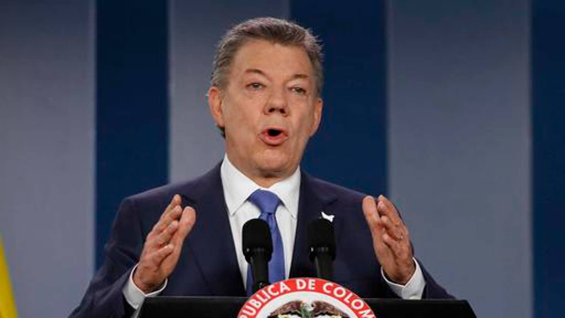 FILE - In this Wednesday, Oct. 4, 2016 file photo Colombiaâs President Juan Manuel Santos delivers a statement to the press after meeting with former President Alvaro Uribe and other opposition leaders at the presidential palace in Bogota, Colombia. Colombian President Juan Manuel Santos has won Nobel Peace Prize it was announced on Friday Oct. 7, 2016.  (AP Photo/Fernando Vergara, File)
