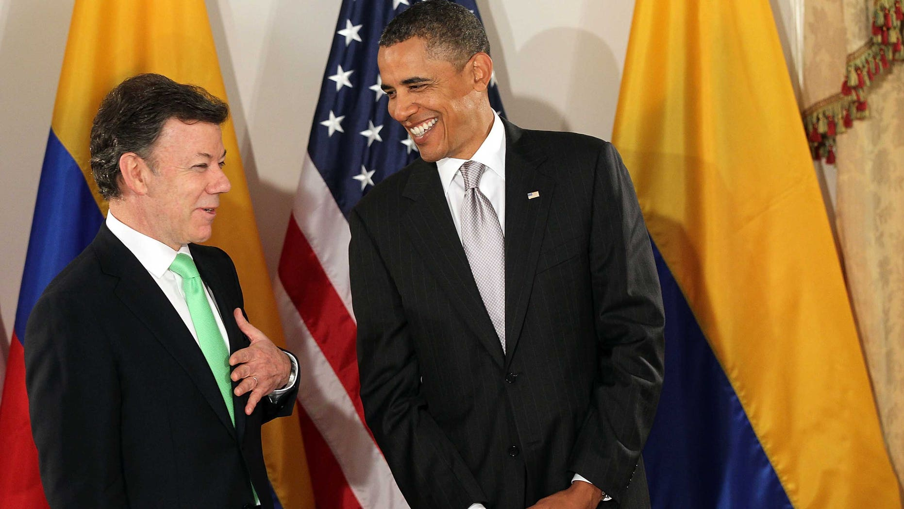 NEW YORK - SEPTEMBER 24:  (AFP OUT)  U.S. President Barack Obama (R) enters a bilateral meeting with President Juan Manuel Santos Calderon of Colombia September 24, 2010 in New York City. Obama has been in New York since Wednesday attending the annual General Assembly at the United Nations, where yesterday he stressed the need for a resolution between Israel and Palestine, and a renewed international effort to keep Iran from attaining nuclear weapons.  (Photo by Spencer Platt/Getty Images)