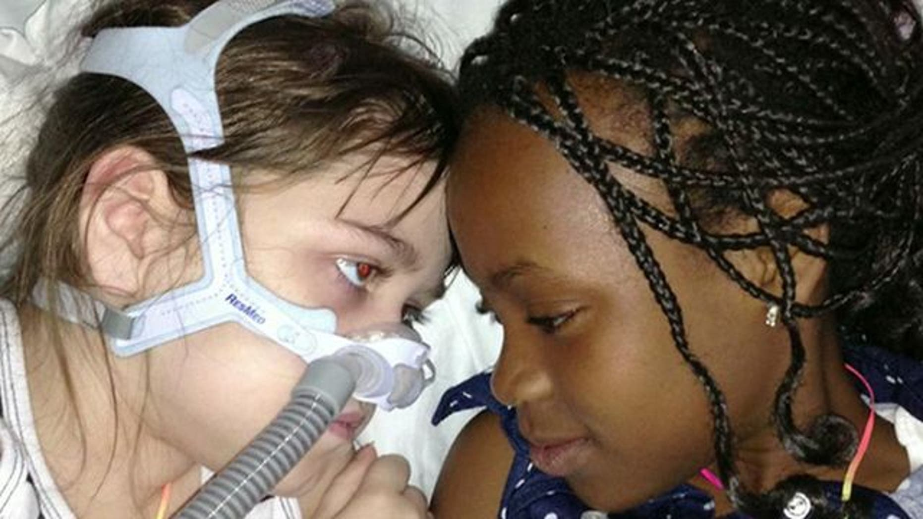 May 30, 2013: Sarah Murnaghan, left, lies in her hospital bed next to adopted sister Ella on the 100th day of her stay in Children's Hospital of Philadelphia.