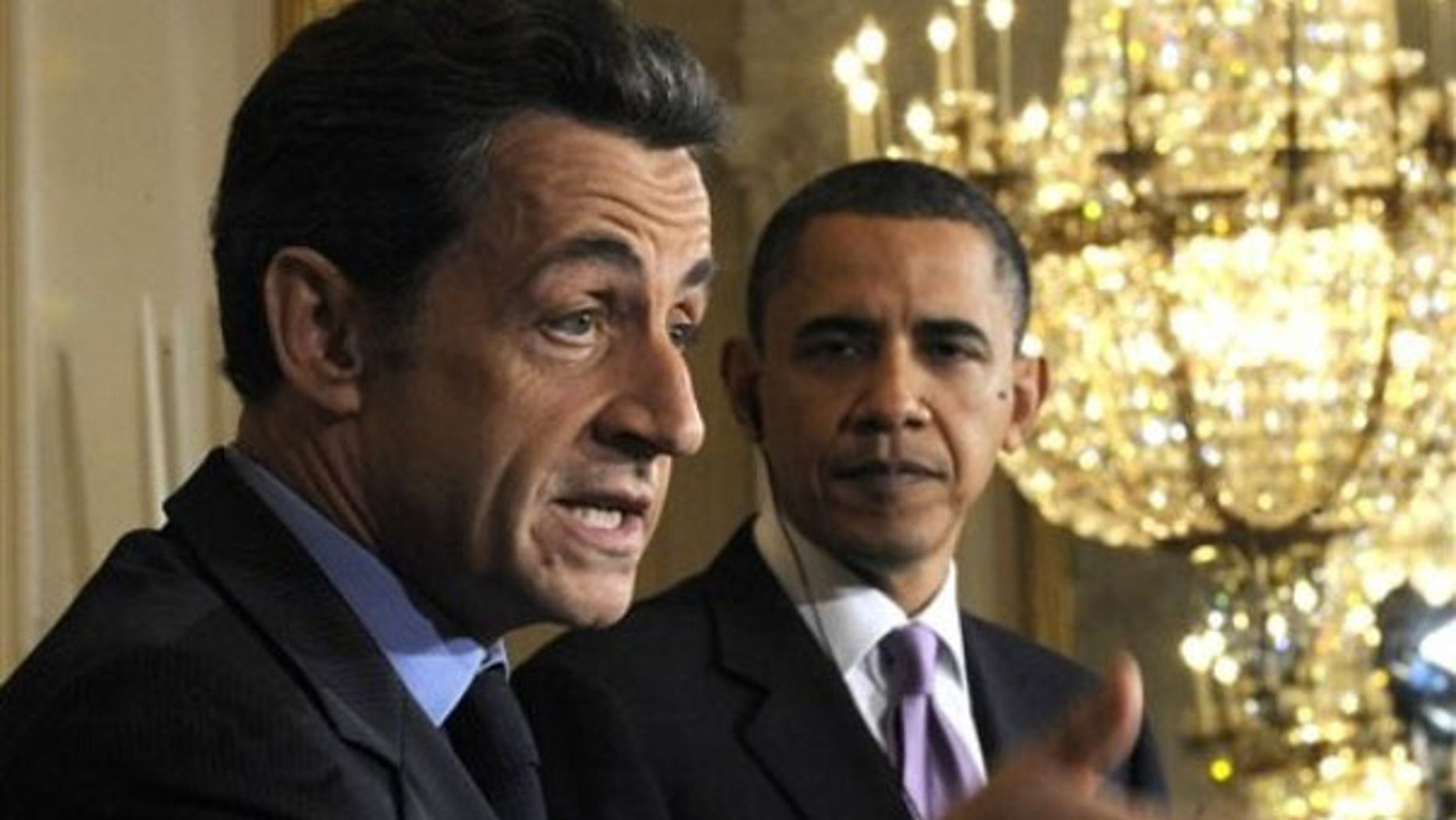 Mar. 30: French President Nicolas Sarkozy speaks as President Obama listens at the White House.