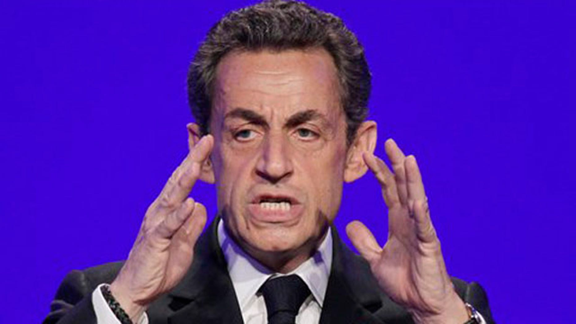 April 5, 2012: France's President and candidate for re-election in 2012, Nicolas Sarkozy, gestures as he speaks to reporters during a press conference as part of his presidential campaign in Paris.