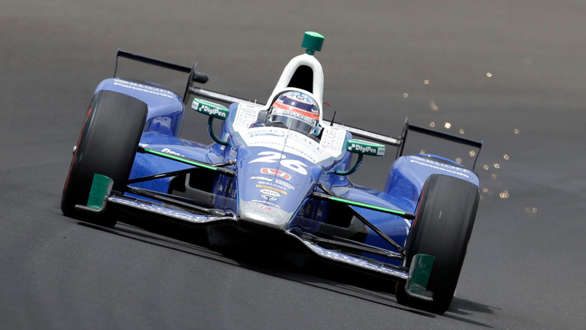 Takuma Sato, of Japan, drives through the first turn during the running of the Indianapolis 500 auto race at Indianapolis Motor Speedway, Sunday, May 28, 2017, in Indianapolis. (AP Photo/Darron Cummings)
