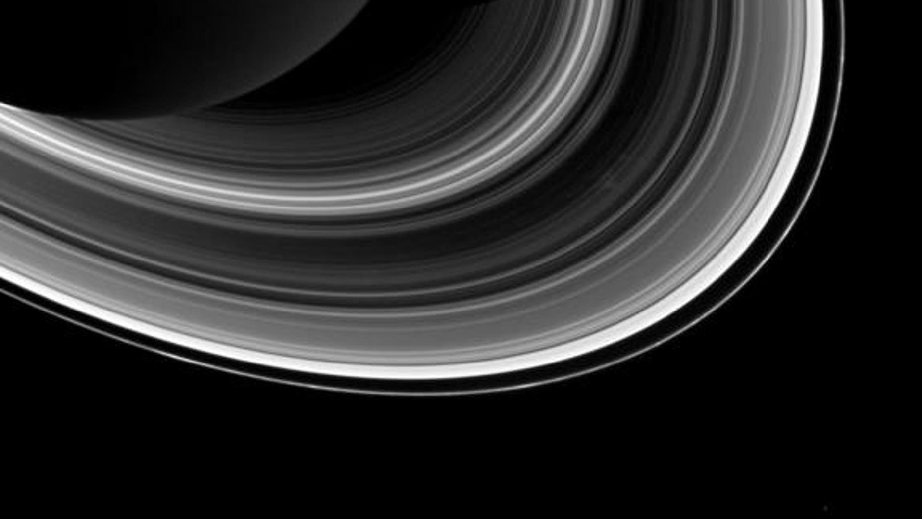 Among the interplay of Saturn's shadow and rings, Mimas, which appears in the lower-right corner of the image, orbits Saturn as a set of the ever-intriguing spokes appear in the B ring.