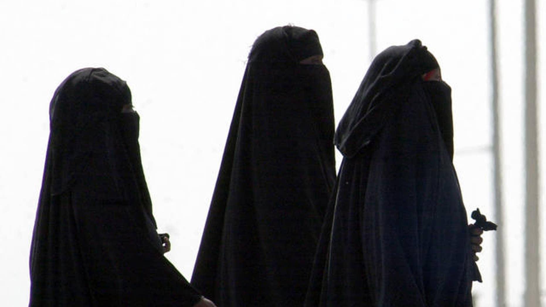 2006 FILE photo of unidentified Saudi women walking along a suburban street in Riyadh, Saudi Arabia.