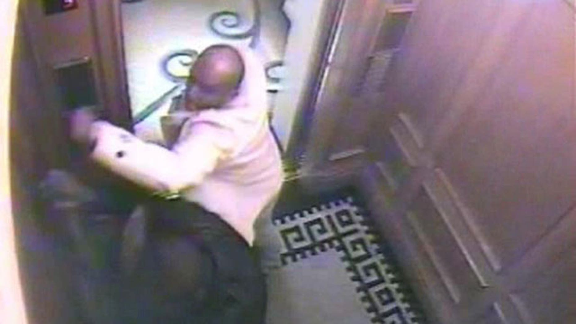 In this CCTV handout image issued by the Metropolitan Police, Saudi Arabian Prince Saud, in white jacket, attacks his servant, Bandar Abdulaziz, in a lift. A Saudi prince has been convicted in Britain of murdering a servant. A jury in London's Old Bailey criminal court, on Tuesday Oct. 19, 2010, found Prince Saud Abdulaziz bin Nasser al Saud guilty of murdering Bandar Abdullah Abdulaziz in a frenzied attack in a hotel. The 34-year-old prince faces a possible life sentence.