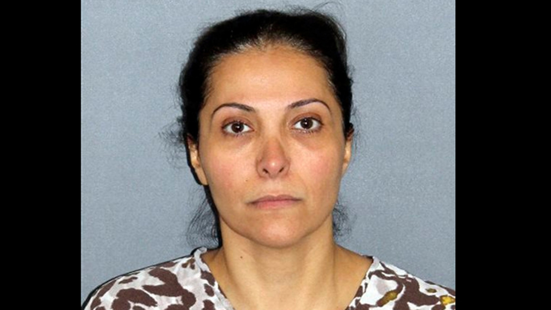 UNDATED: This image provided by the Irvine Police Department shows Meshael Alayban, who was arrested July 9, 2013 in Irvine, Calif., for allegedly holding a domestic servant against her will.